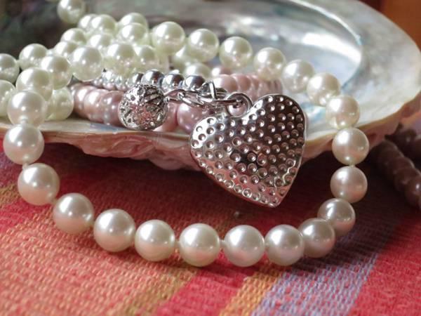 唯美的珍珠项链图片_WWW.66152.COM