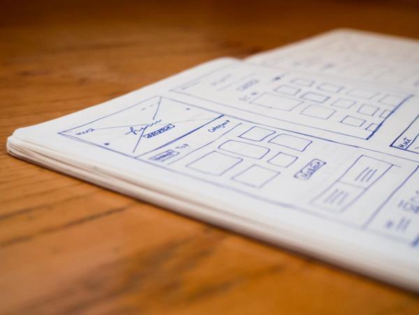 笔记本上的线框草图图片_WWW.66152.COM