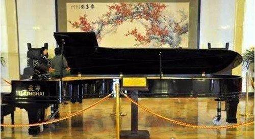 世界上最大的钢琴_WWW.66152.COM