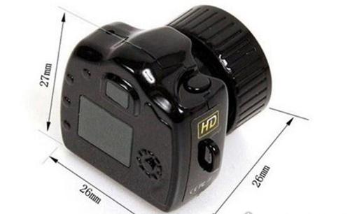 世界上最小的照相机_WWW.66152.COM