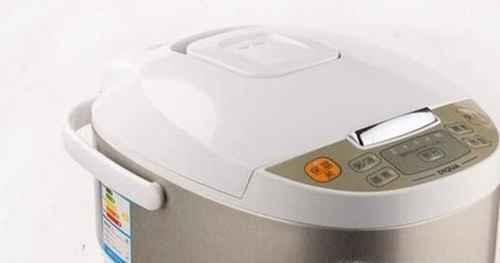 如何用电饭煲煮米饭_WWW.66152.COM