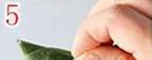 三角粽子的包法_WWW.66152.COM
