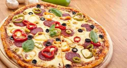 披萨成型的技巧_WWW.66152.COM