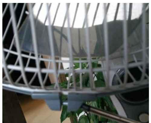 美的落地电风扇怎么拆_WWW.66152.COM